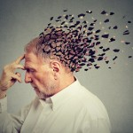 Memory loss due to dementia. Senior man losing parts of head  as symbol of decreased mind function.