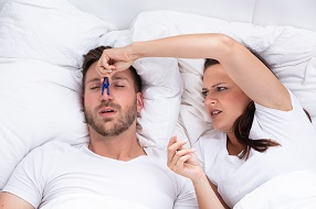 Woman Trying To Stop Man's Snoring With Clothespin